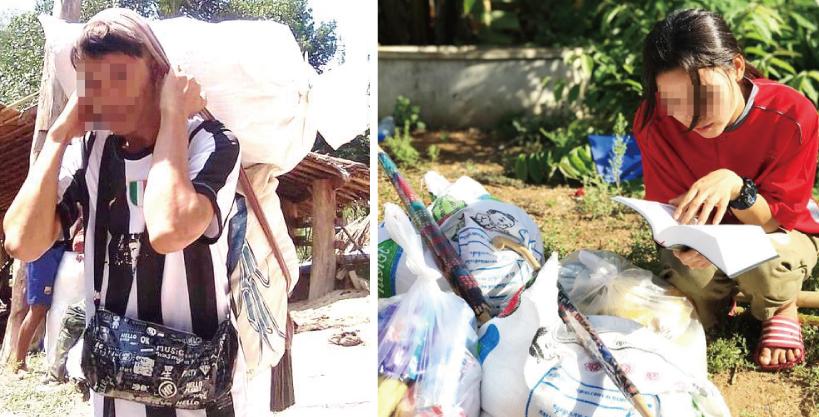 支援物資の聖書を読む避難民